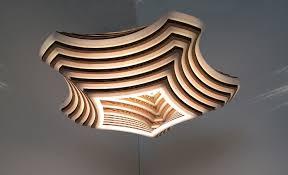 home lighting design 2015 artisan design source debuts stunning laser cut lighting at bklyn