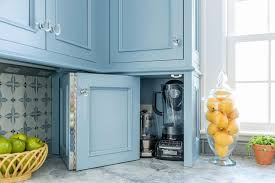 kitchen cabinets with blue doors folding blue cabinet doors to small appliances cabinet