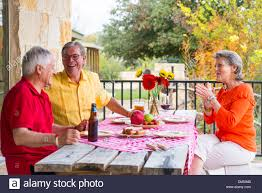 retired people two me one woman at a backyard barbecue party