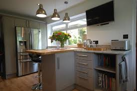 quinag stone and mussel kitchen with solid oak and colonial white