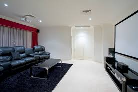 projector vs tv home theater use that extra space building home theater systems mckinney tx