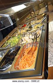 asia chinese buffet self serve food in silver trays in malaysia