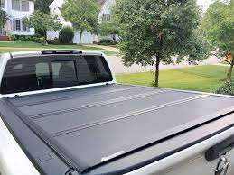 nissan titan bed rack extang solid fold 2 0 tonneau with titan boxes and utilitrac