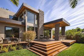 modern prefabricated modern home with stacked stones pillars and