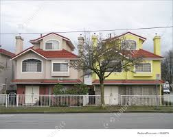 picture of twin houses painted with different colors