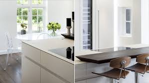 kitchen with an island a quartz top and a breakfast bar