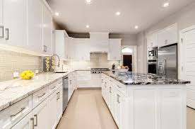 white cabinets with white granite white kitchen with gray glass backsplash and granite countertop