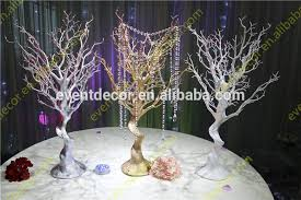 white plastic tree branches tree centerpieces for wedding