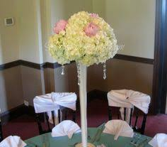 hydrangea in eiffel tower vases for a tall centerpiece peonies