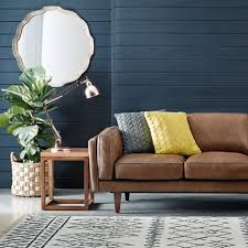 Navy Leather Sofa by Leather Sofa With Knitted Throw Pillows Oversized Mirror Dark