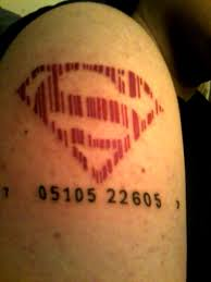 superman logo barcode tattoo on man shoulder by miles yagami