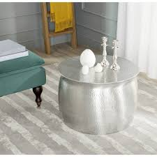 small metal end table organizing small living room spaces with hammered round silver metal