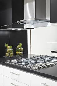 appliances modern kitchen design glass canister black granite modern kitchen design glass canister black granite countertop white cabinets stainless steel glass range hood stainless steel stove top