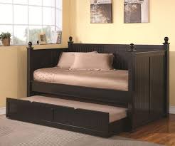 black stained wooden trundle daybed with brown silky bedding set