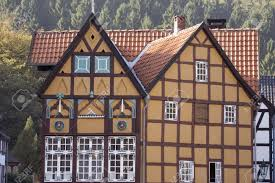 german village with timbered houses in warm sunlight and autumn