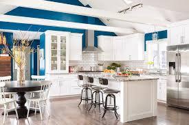 White And Blue Kitchen - white and blue kitchen with wood beams on vaulted ceiling