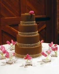 wedding cake og chocolate tier cake with gold leaves gorgeous flowers cakes