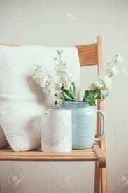 vintage home decor white matthiola flowers in a blue jug on