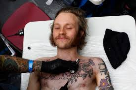 emil is tattooed by tattoo artist deno during the ninth london