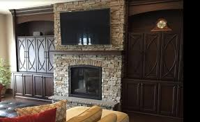 arched stone fireplace frame
