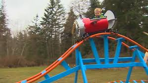 roller coaster for backyard how cool is this navy pilot builds roller coaster in backyard for