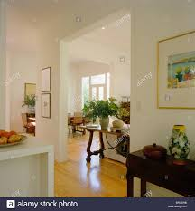 modern open plan white hall with antique console table beside