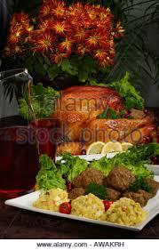 Turkey On The Table Roast Turkey On Serving Platter With Roast Potatoes Vegetables