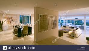 modern open plan kitchen dining room living room modern openplan dining room with steps down to living