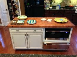 kitchen island with cutting board top kitchen island with cutting board top s unters y rolling kitchen