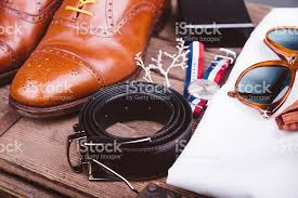 Mens Bench Watch Mens Shoes Belt Watch And Sunglasses On Wooden Bench Stock Photo
