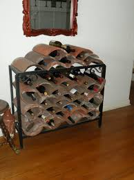 riveting triangular wood wine rack this wine rack is handmade from