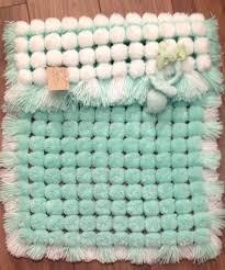 Pom Pom Rug Instructions Making A Pom Pom Blanket Loom Blanket Craft And Loom Knitting