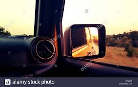 jeep lifestyle view in jeep rearview mirror stock photos u0026 view in jeep rearview