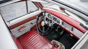 pujo car riding in the 1966 peugeot 403b autoweek