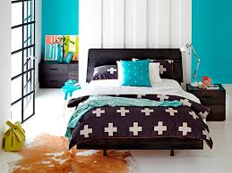 Bedroom Ideas With Teal Walls Teal Wall Color With Black Wooden Bed Frame For Modern Master