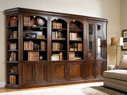 white bookshelf with glass doors large varnished brown wooden bookcase with many shelves completed