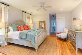 beautiful beachstyle bedroom white door features wood floor beach