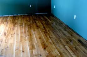 rustic cheap wood flooring installation with blue wall part of