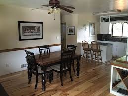 traditional dining room with ceiling fan u0026 hardwood floors in twin