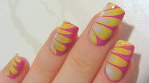 yellow and pink water marble nail art