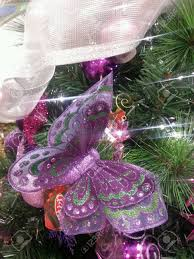 christmas butterfly decorations on christmas tree stock photo