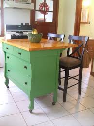 unique small green kitchen island with bar seating along with