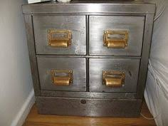 painting metal file cabinets how to turn an old filing cabinet or an old dresser into a gorgeous