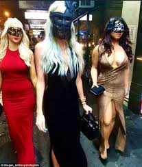 imogen anthony wears black mask and sking tight gown for masked