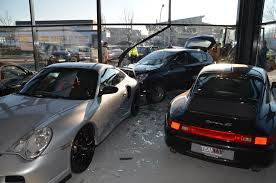 porsche showroom man crashes opel astra into a porsche dealership