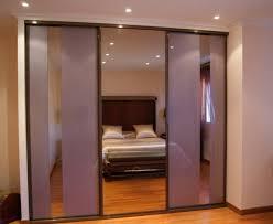 placard encastrable chambre portes coulissantes en verre laqué et miroir bronze à la fare les