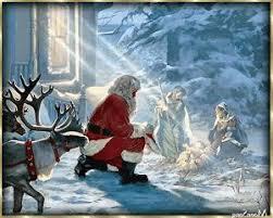 santa kneeling at the manger this picture adoring santa and