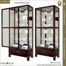 large display cabinet with glass doors howard miller large cherry curio display cabinet 680515 williamson
