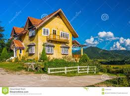 vintage european style of yellow house on hill in countryside