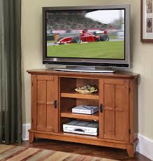 corner tv stand with glass doors home styles arts and crafts 2 door corner entertainment cabinet